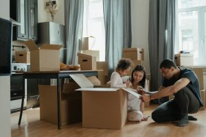 A family unpacking boxes